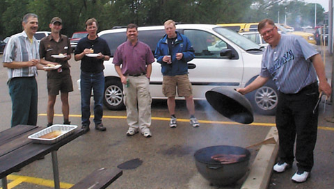 Jeff feeds the hungry crew: (from left) Paul LoBue, the UPS Guy, Don Larson, Steve Davies, Matt Harr, and Jeff Kranz