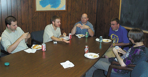 The daily card game: (from left) Jason Laux, Adam Derringer, Paul Crowder, Pete Stangel, and William Kyngesburye