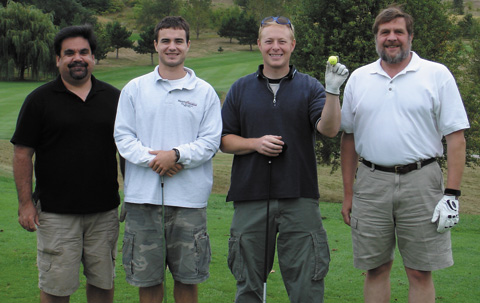 The golf outing after the 2005 Annual Meeting. Shown left-to-right: Dave Knipfer, Cody Thiede, Matt Harr, Alan Craig.