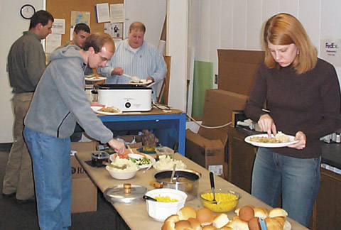 ason Laux, Cody Thiede, Mike Davis, Mike Woodard, and Mary Swab dig in at the annual Thanksgiving Turkey Dinner.
